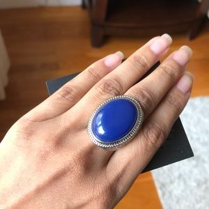 Costume blue stone ring in silver setting